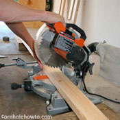 Cutting wood with a mitre saw.